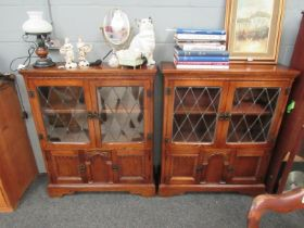A pair of late 20th Century old charm style lead glazed cabinets,