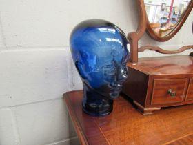 A blue glass head
