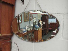 An Art Deco oval wall mirror,