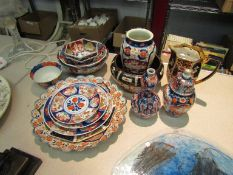 A quantity of modern Imari style china to include charger, bowls, vase etc.