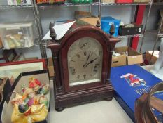 A mahogany bracket clock in the Georgian style with silvered face inscribed 'Biggs & Sons,