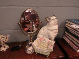A ceramic cat, mirror,