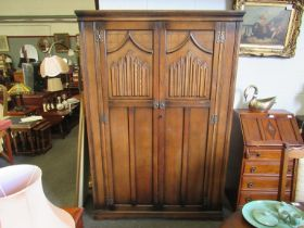 An old charm oak two door wardrobe with linen fold decoration,