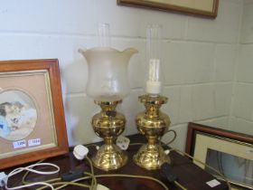 Two brass based electric oil lamps (one missing a shade)