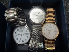 A selection of watches including a Citizen Eco-Drive, Seiko quartz,