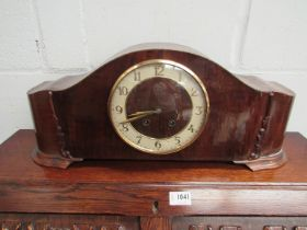 A 1950's oak and walnut striking mantel clock with Arabic chapter ring,