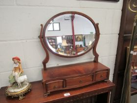A lady's toilet mirror with three jewellery drawer base