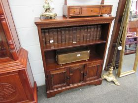 An old charm style bookcase with two cupboard door base,