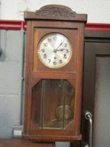 An oak cased wall clock, 1940's,