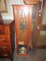 A Synchronome electric slave clock with invar pendulum, a/f, teak case.
