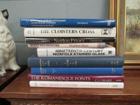 Nine assorted volumes on Romanesque art, Romanesque enamels, Norfolk stained glass, Flint Flushwork,