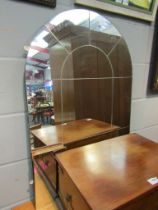 An arch top over mantel mirror, one pane loose,