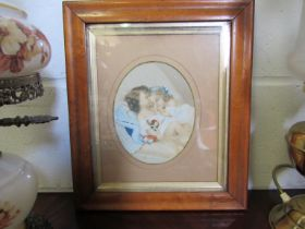 A Victorian maple framed print of two sleeping girls,