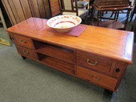 A modern hardwood four drawer TV unit,