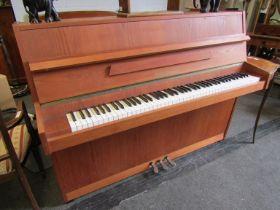 A Zimmermann upright piano in teak
