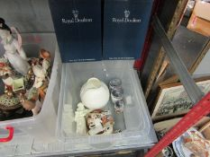 A box containing boxed Doulton figurines, Worcester figure, Worcester egg coddlers,