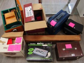 A collection of photographic equipment including projector screen, Eumig P8 projector,