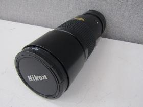 A Nikon Nikkor 300mm zoom lens, serial no.
