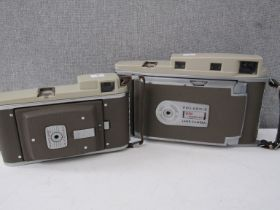 Two Polaroid Land Cameras including 850 Electric Eye