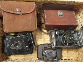 "Four various vintage cameras including Coronet ""Vogue"" Bakelite Deco camera and Vest pocket Kodak"