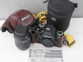 A Nikon F2 SLR camera in black with Nikon AF Nikkor 80-200mm lens and Nikon case