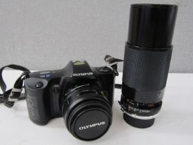 An Olympus OM101 Power Focus SLR camera with accessories