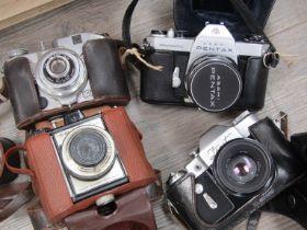 Four cameras including Koroll and Pentax Spotmatic SPII SLR
