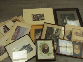 A collection of framed and unframed photographs including Queen Victoria,