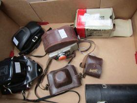 A box of mixed cameras including Voigtlander Vito B
