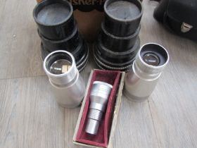 A collection of projection lenses including two Zeiss cinemascope Anamorphot and Bell & Howell