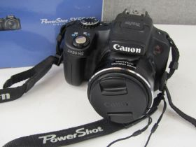 A Canon Powershot SX50 HS bridge digital camera,