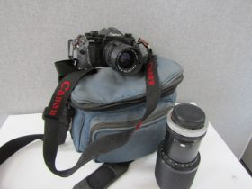 A Canon A1 SLR camera with lenses,