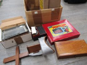 A stereoviewer together with glass slides and peep-show kit,
