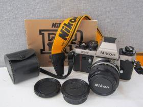 A Nikon F3/T Titanium SLR camera with 50mm lens and manual