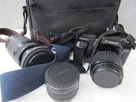 A Canon EOS 1000F SLR camera with 35-80mm and 75-300mm lenses and accessories,