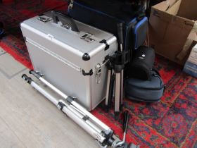 A quantity of camera cases and two tripods