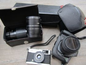 A quantity of cameras and equipment including Canon EOS600 SLR and Olympus Trip 35