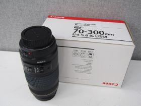 A Canon EF 70-300mm USM ultrasonic zoom lens,