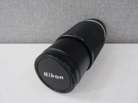 A Nikon 70-210mm series E zoom lens, serial no.