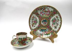 A Cantonese porcelain teapot in original wicker basket with padded interior.