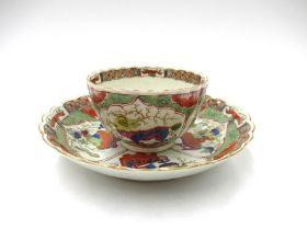 "A First Period Worcester ""Bishop Summer"" pattern tea bowl and saucer"
