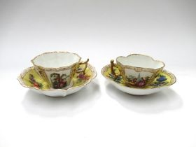 Two similar 19th Century Dresden yellow ground cups and saucers