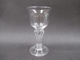 An 18th Century sweatmeat glass with lipped ogee bowl set onan octagonal Silesian stem,
