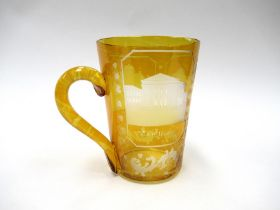 A mid 19th Century engraved amber flashed Continental spa mug with handle, c.1860. 10cm tall.