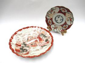 A Japanese charger painted in iron red and black with figures, 30cm diameter.