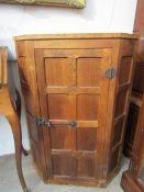 "A Robert Thompson ""Mouseman"" oak corner cabinet. 97cm high."