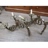 A pair of 19th Century ormolu Gothic wall lights