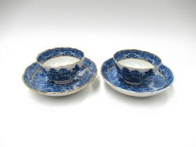 A pair of Caughley blue and white tea bowls, Willow pattern, small chips and cracks to bowl.