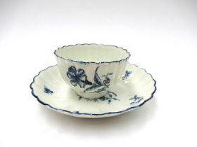 """A First Period Worcester blue and white """"Cornflower"""" pattern tea bowl and saucer"""