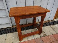 """A Robert Thompson """"Mouseman"""" oak stool. 39cm high."""